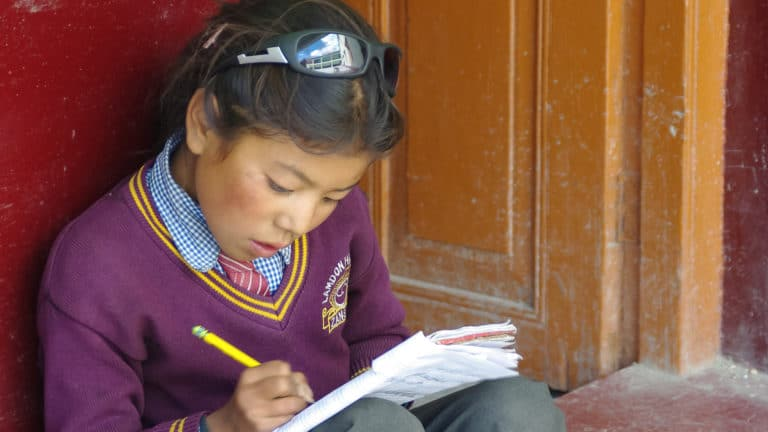 Student with her notebook at LMHS in Zanskar
